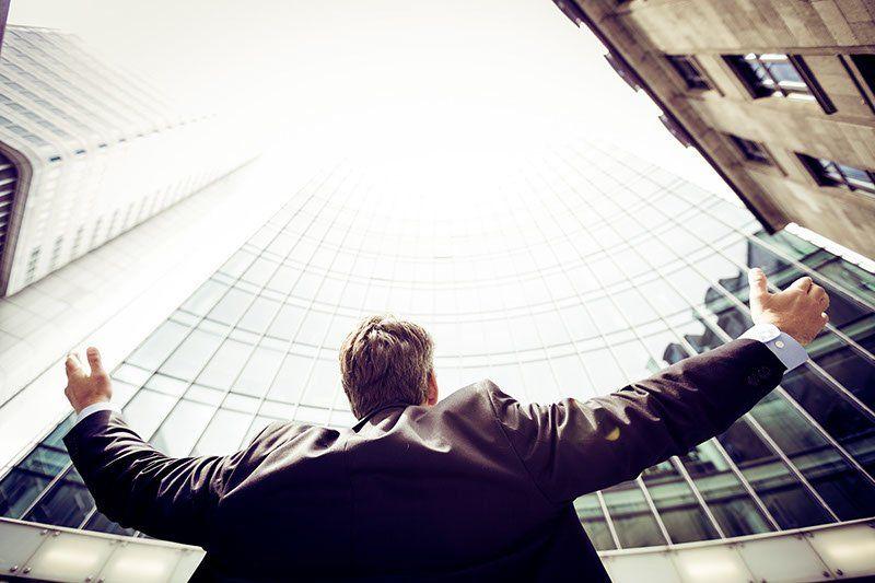 Man looking at Office Block
