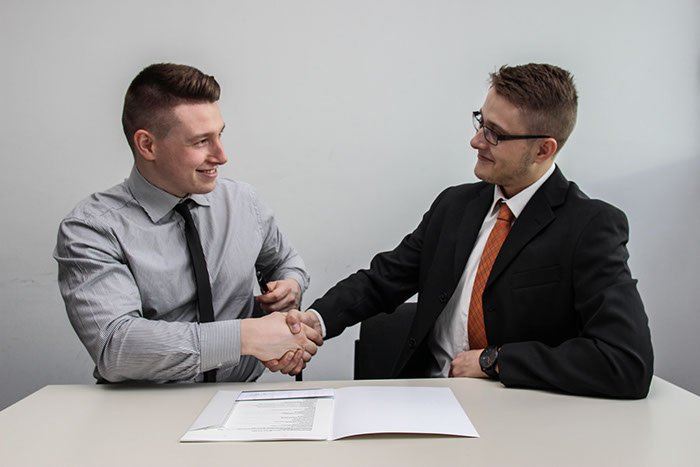 Two People shaking hards after interview